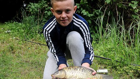 Blaine English with the second-biggest fish caught, a 2lbs carp. Picture: Chris Bishop