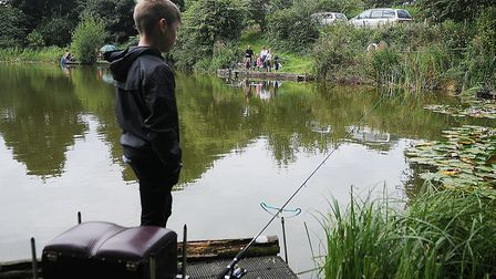 An angler tries to tempt a carp in the margins of the lake., Picture: Chris Bishop