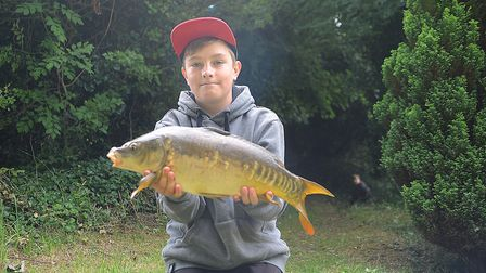 Daniel Boughen with the biggest fish caught on the day, a carp of just over 6lbs. Picture: Chris Bis