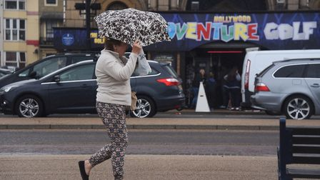 An umbrella struggles against the wind and rain at Great Yarmouth sea front. Picture: DENISE BRADLEY