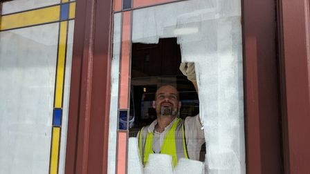 The windows being painted over.The Troll Cart Wetherspoon pub in Great Yarmouth has closed for refur