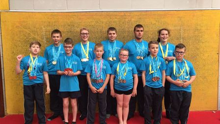 The Eastern Region Special Olympics gymnastics team with their medals. Picture: Courtesy of Waveney