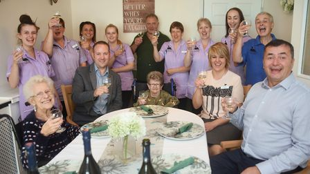 Residents Gladys Rushmere, 89, left, and Mary Calcutt, 81, share in the celebrations with the staff
