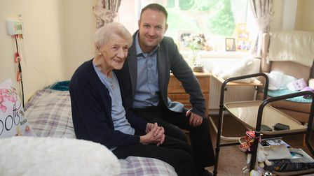 Clarice Maggs, aged 101, in her room chatting to managing director, Tom Lyons, at the Beeches Care H