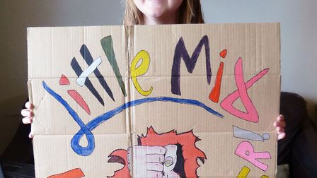 Robyn Clarke, aged 11, with her winning poster. Photo: Courtesy of Kerry James