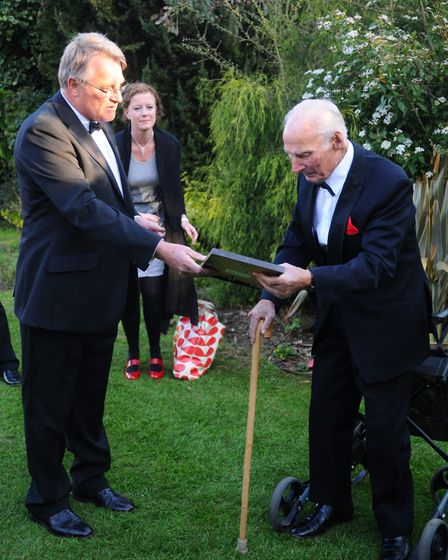 Bob Sutton, right, being surprised with a long-service award ahead of the Wymondham Rugby Club annua