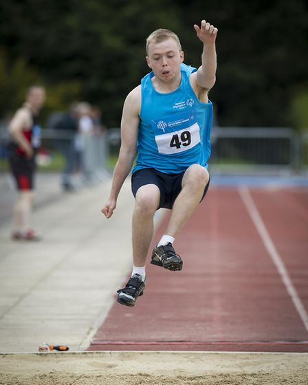 Cameron Ross from South Wootton leaps to a silver medal in the long jump. Picture: Michael Lyons