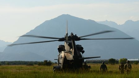 An Italian Air Force HH-101 Caesar extracts a team of Guardian Angels assigned to the 57th Rescue Sq