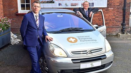 The unveiling of the Veterans' Response Partnership car. Right, director of the Walnut Tree Project