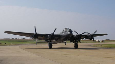 The Battle of Britain Flight's Lancaster Bomber, one of just two still flying in the world, takes of