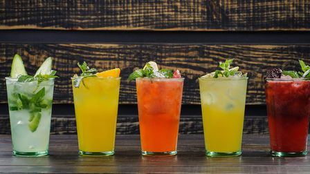 Sip on a cocktail at one of our favourite bars. Picture: Getty Images/iStockPhoto