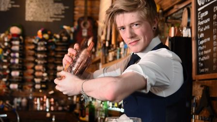 Gonzo's bartender Jackson Swallow with his cocktail called Jimmy Rustler, which has won him a place