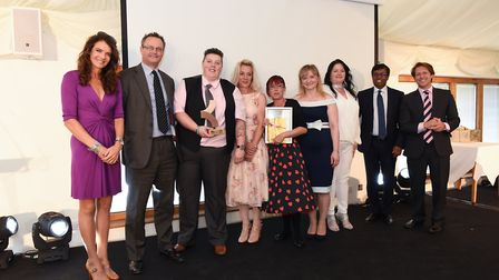 Staff from Kirkley Manor nursing home in Lowestoft collecting the care home of the year award at the