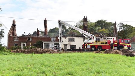 Flashback. Fire crews attend the blaze at the Ingham Swan pub and the Scotts' property next door. Pi