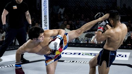 Zeith Mon, left, lands a spinning kick in his 73kg pro K1 title defeat to the impressive Aadeep Rana