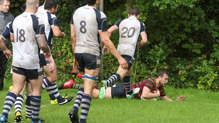 Laurence Austin goes over for Norwich during their hard-fought win at Cantabrigian. Picture: Andy Mi