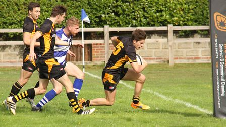 Josh Wallis races through for Southwold during their emphatic derby win at Lowestoft & Yarmouth. Pic