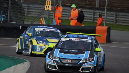 Josh Files (1) battling with rival Mike Halder on his way to victory in race two. Picture: TCR Germa