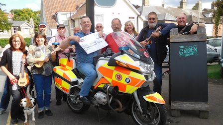 Cheque presentation to Norfolk Serv from the the Norfolk Ukelele Society who raised �700. Seated on