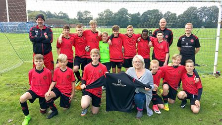 Photo, attached, shows Reffley u14 being presented with their new kit by Leanne Berycz from Ring Ass