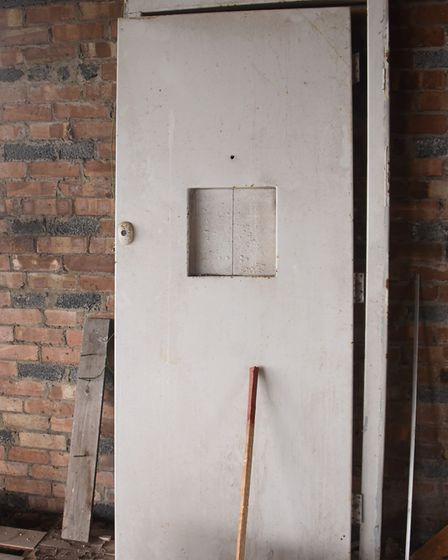 One of the RAF metal interior doors at the former RAF Raynham Control Tower. Picture: DENISE BRADLEY