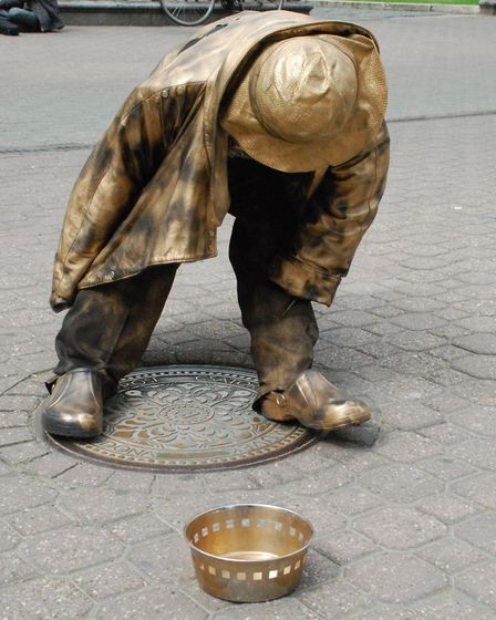 A statue of a beggar in Budapest. Photo: Alec Hartley