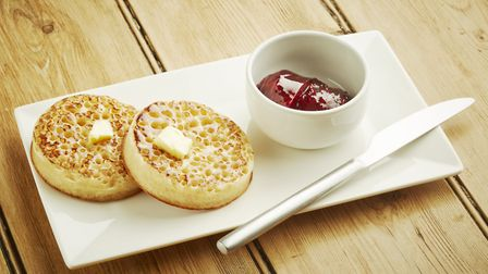 Crumpets toasted on white dish and wooden table top. Photo: PaulMichaelHughes/Getty Images/iStockPho