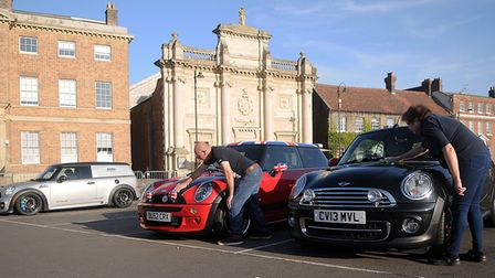 Mini owners Trevor and Julia Robinson polishing their cars ready for today's Mini meet in King's Lyn