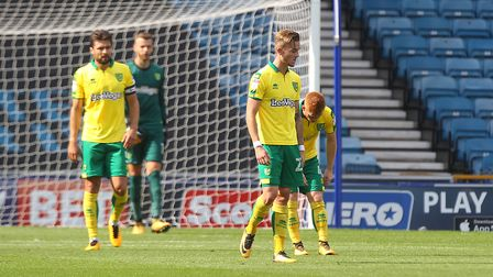 The Norwich players look dejected after conceding their sides 3rd goal during the Sky Bet Champions