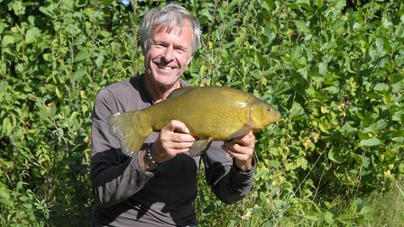 John Bailey with his dawn tench caught with wonder watercraft. Picture: John Bailey