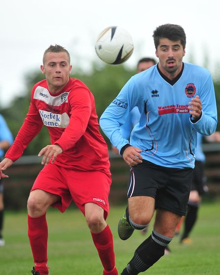 Aiden Lowe, right, playing for Bungay Town FC in a match last year against Sheringham. Picture: Ar