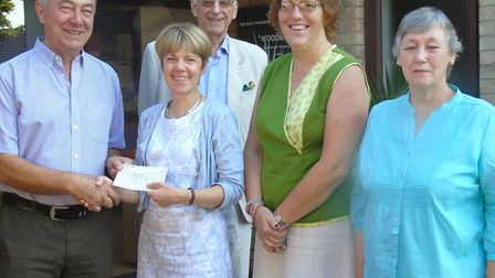 Chris Trenerry of Woodcote Social Club, left, presenting a cheque for �500 to Dr Nicky Morris of Het