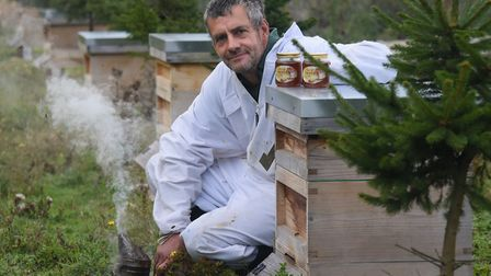 Beekeeper Simon Greenwood with some of his hives he has left after thieves stole hives, with thousan