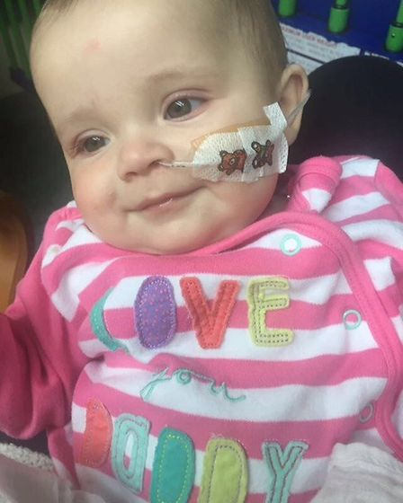 Little Bella's first smile after her experience in hospital. Picture: The Sick Children's Trust