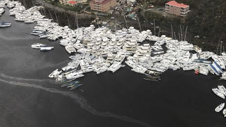 This photo provided by Caribbean Buzz shows boats clustered together after Hurricane Irma Friday. Pi