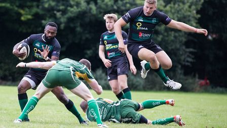 Vilikes Vurewa with ball as James Knight vaults over an opposing player during North Walsham's win.