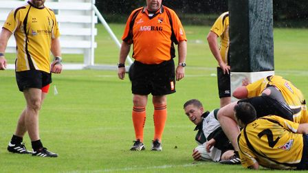 Action from Norwich Union's 60-14 home win over Swaffham - NU's Graham Hunt scores his second try of