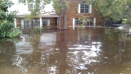 Chris Bell said his brother and parents, who live in the city of Vidor, had to be rescued by the Nat