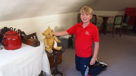 Liam Long, 10, the son of Hingham Antiques Fair dealer Hailey Long of Norfolk House Clearances, was