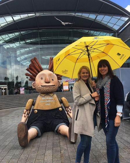 Emma Osborne, left, and Deborah O'Malley from Aviva with a supersized version of the puppet 'Boy' f
