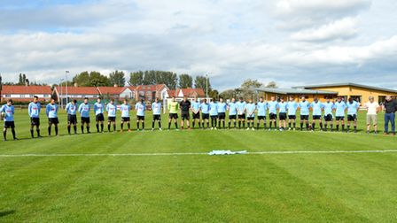 Bungay Town Reserves, left, and first team at the four-team minute's silence. They were also joined