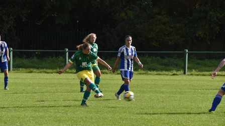Emily Moerkerk slots the ball through with Grace Parker watching on. Picture: Brian Coombes