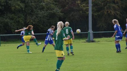 Charlotte Broad strikes the ball with Luka Goodfield in the foreground, Picture: Brian Coombes