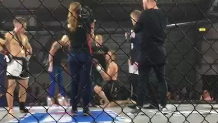 Damantas Matulevicius goes down on one knee to propose to his girlfriend in the cage at Contenders 2