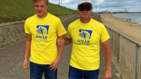 Jeremy Goss sets off on his blindfold walk from Gorleston, guided by his son Jacob. Picture: Andy Ne