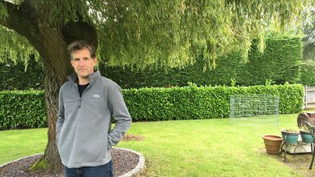 Builder Simon Cobbe, who lives next door to the man who was injured when an internal wall fell on hi