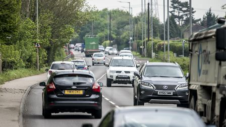 Traffic on the A10 at West Winch. More than 1,000 new homes could be built around the village. Pictu