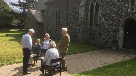 MP Norman Lamb in the churchyard at Trimingham, on his village tour. Pictures: Ed Keyser
