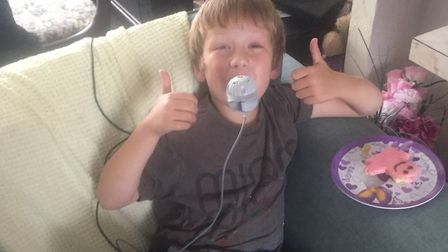 Daniel Watkinson, six, using an eflow nebuliser, the same as the one lost and presumably stolen in D