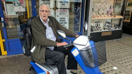 Peter Nicol, 73, had the waterproof cover from his mobility scooter. Photo: George Ryan